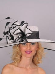 Those who fancy their hats, say smart women, pick the Derby hat first, then the dress. Black and white always makes a statement, DeLaine says.