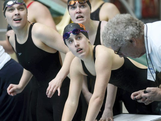 Members of the York Suburban girls' 200 freestyle relay team watch their time during the Class AA District 3 swimming championships at Cumberland Valley High School on Feb. 27.