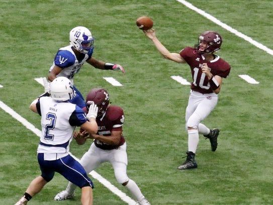 Johnson City quarterback Gavin McKercher makes a throw