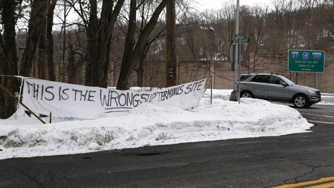 A sign opposing the location as the entrance for a walking/biking path for the new Tappan Zee Bridge hangs at the intersection of South Broadway and Cornelison Avenue, Feb. 26, in South Nyack. It's been up since last November.