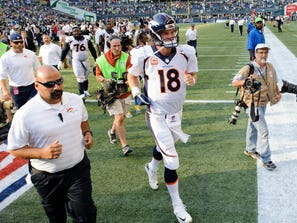 Sep 21, 2014; Seattle, WA, USA; Denver Broncos quarterback Peyton Manning (18) jogs off the field after the game between the Seattle Seahawks and the Denver Broncos at CenturyLink Field. Seattle defeated Denver 26-20.