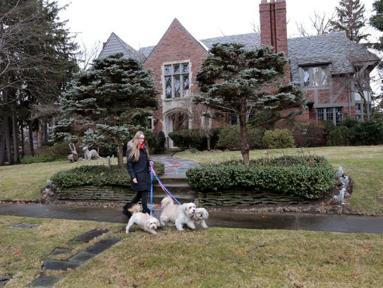 Denise Carter, 20, of Ferndale walks 3 dogs for a resident