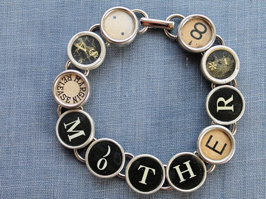 The Mother typewriter key bracelet by Joy Sparks Designs.