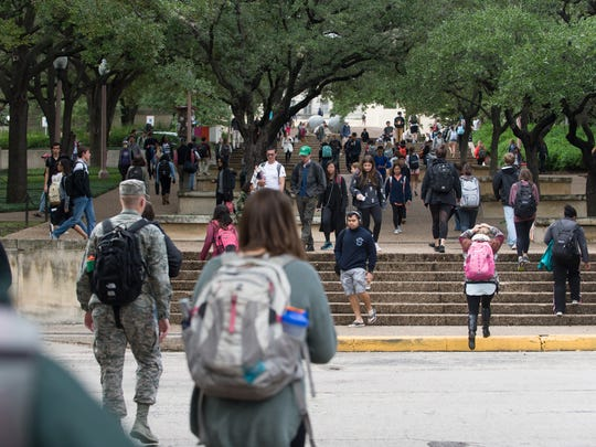 Students fill the sidewalks between classes in November at the University of Texas-Austin.