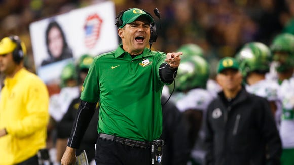 Oct 17, 2015; Seattle, WA, USA; Oregon Ducks head coach Mark Helfrich reacts to a spot of the ball by the officials during the third quarter against the Washington Huskies at Husky Stadium. Mandatory Credit: Jennifer Buchanan-USA TODAY Sports