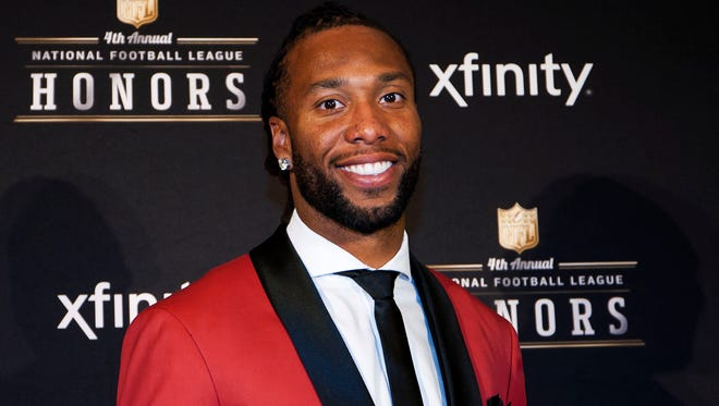 Larry Fitzgerald accepts the Art Rooney Sportsmanship award at the 4th Annual National Football League Honors in Phoenix, Saturday Jan. 31, 2015.