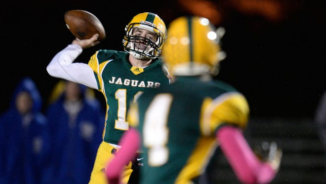 Ashwaubenon quarterback James Morgan throws to wide receiver Sam Wisneski (4) in Friday's game against Notre Dame.