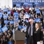 Democratic presidential candidate Sen. Bernie Sanders, I-Vt., center left, waves to the crowd with his wife Jane after speaking during a primary night watch party Feb. 9 in Concord, N.H.