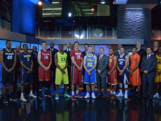 Players and coaches pose at Pac-12 Media Day at Pac-12
