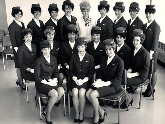 Mayor Patty Lent as flight attendant. She is standing in the back row, far left.
