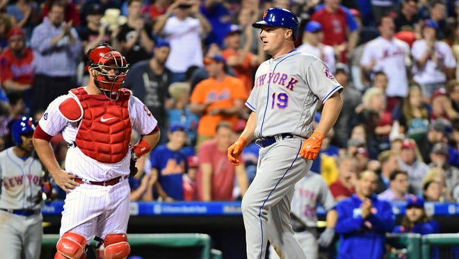 New York Mets right fielder Jay Bruce (19) steps on home plate after hitting a two-run home run during the eighth inning against the Philadelphia Phillies at Citizens Bank Park on April 10.