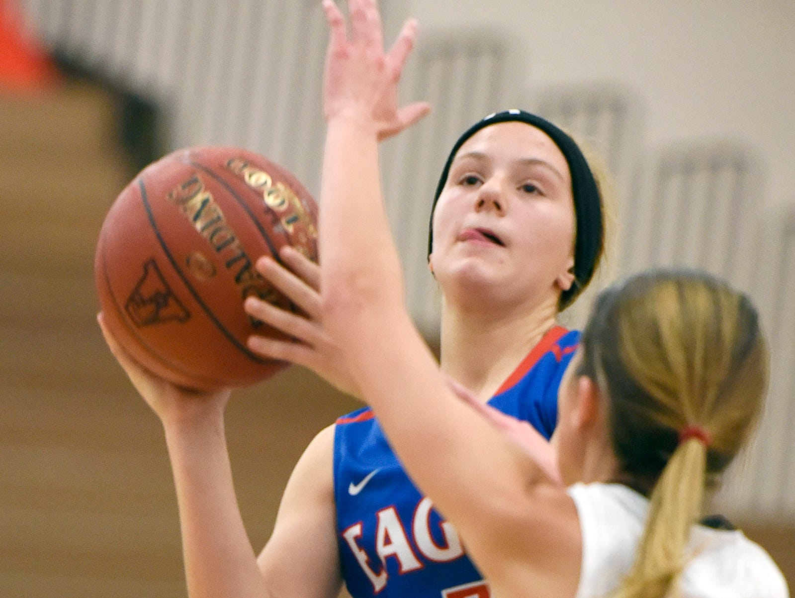 Apollo's Ashley Koepp get a shot off over Tech's Sidney Angell during the first half Tuesday, Dec. 8 at Apollo High School.