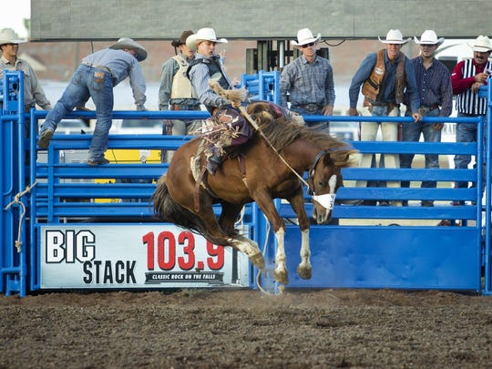 "Zeke Thurston, from Big Valley, Alberta, rides ""Strip"""
