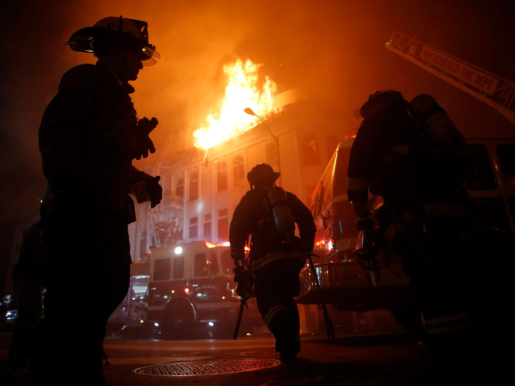 Firefighters battle a four-alarm fire at 22nd and Mission Street on Jan. 28 in San Francisco. One person was killed and four people were injured in the massive Mission District blaze.