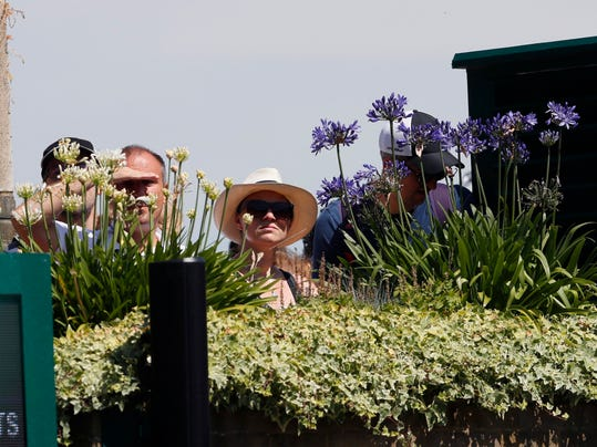 Spectators watch a match, on day five at the Wimbledon Tennis Championships in London Friday, July 7, 2017. (AP Photo/Kirsty Wigglesworth)
