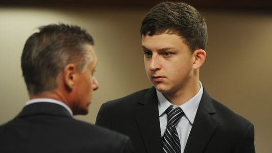 Kyle Ramsey, 18, discusses his case with defense attorney Steve Lynch. The Birmingham teenager was arraigned Tuesday, April 14, 2015,  on a felony marijuana delivery charge.