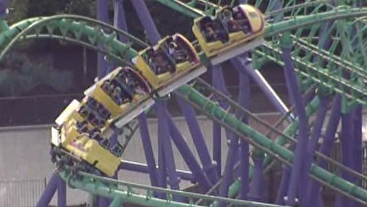 A rollercoaster is stuck in the air with dozens of riders on board at Six Flags America.
