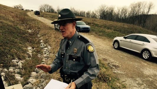 A Kentucky State Police spokesman addresses media the morning of Dec. 22, when police shot and killed armed robbery suspect Allen Berly Todd, Jr.