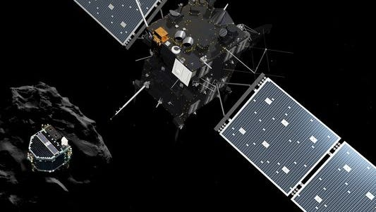 The image released by the European Space Agency ESA on Wednesday, Nov. 12, 2014, shows an artist rendering by the ATG medialab depicting lander Philae separating from Rosetta mother spaceship and descending to the surface of comet 67P/Churyumov-Gerasimenko.