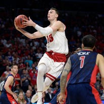 Wisconsin Badgers forward Sam Dekker (15) moves to the basket against Arizona Wildcats during the second half in the finals of the west regional of the 2015 NCAA Tournament at Staples Center.