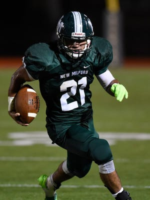Christian Correa ran for 226 yards on 38 carries with two touchdowns in New Milford's win over Becton.  Correa is in the running for The Record's Player of the Year honors.