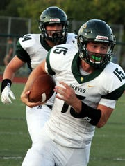 Groves quarterback Beau Kewley scored twice and threw for another touchdown in Thursday's OT loss to West Bloomfield.