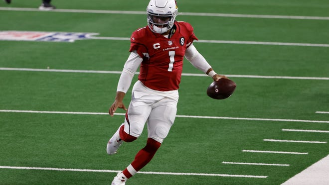 Cardinals quarterback Kyler Murray heads to the sideline after gaining yardage carrying the ball against the Cowboys in the first half Monday night.