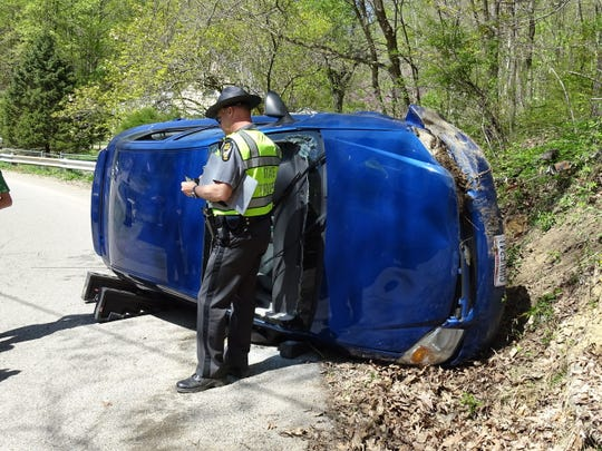 State Troopers investigate a single vehicle crash on England Hollow in Chillicothe.
