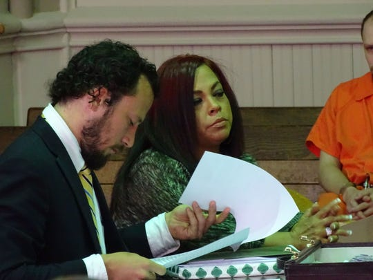Patricia L Thomas sits sits with her attorney Adam Grosshandler before Judge Mark Fleegle sentences her to 17 months in prison on multiple theft charges. Thomas pleaded guilty to 16 counts accusing her of stealing from elderly patients at a nursing home where she worked.
