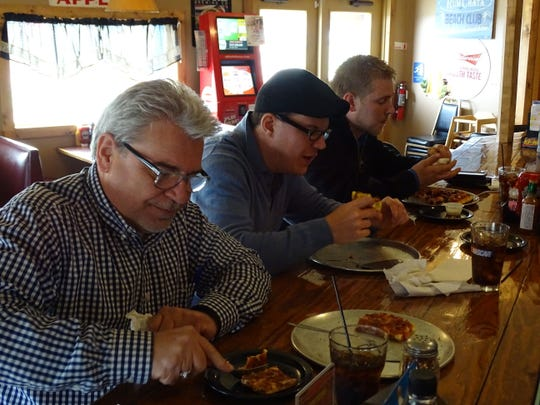 Paul Ramey, pictured left, Tony McBride and Chad Gerold eat lunch Wednesday at Buckeye Fire and Grill in Clyde. The three men said they were eating at the restaurant for the second day in a row.