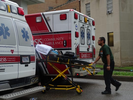 A worker unloads a gurney from a Community Ambulance at Good Samaritan Hospital on Saturday. A total of 91 patients were transported from Good Sam to the new Genesis Hospital on Maple Avenue, which opened this weekend.
