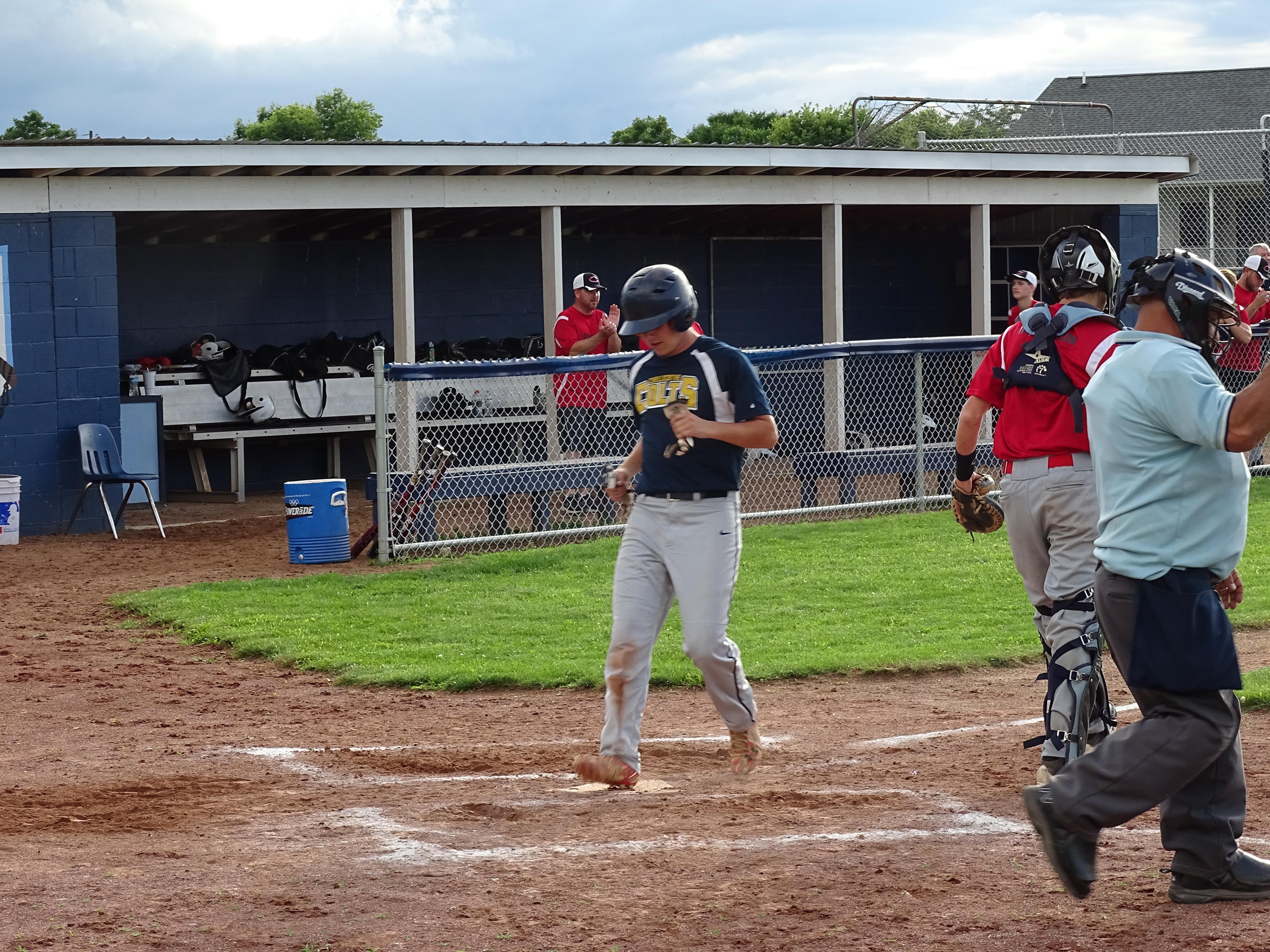 Post 757's Zack Jordan crosses home plate, Thursday, against the Chillicothe Cobras at Adena High School.