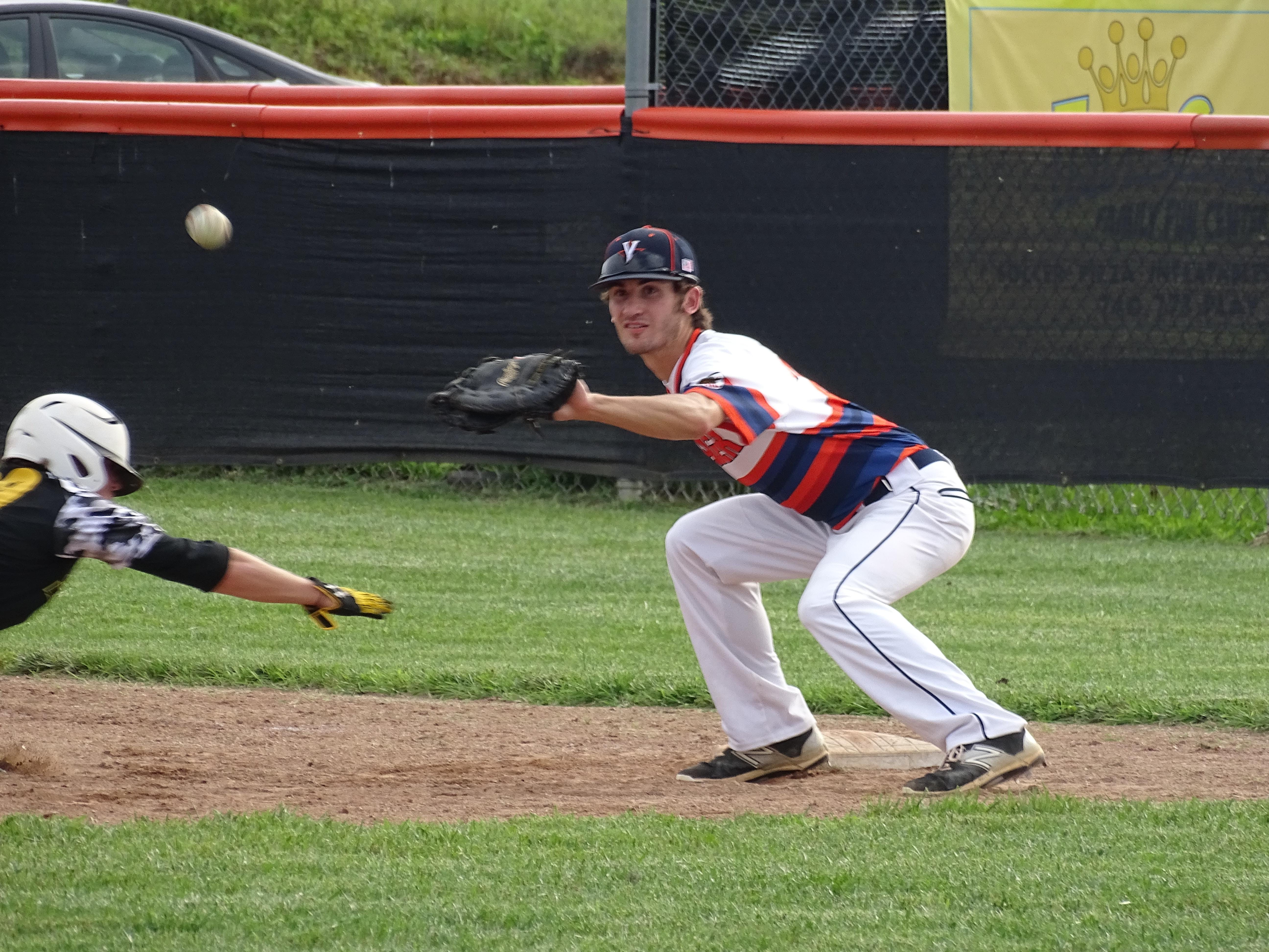 Cincinnati Yeager first baseman Matthew Kron fields a pickoff attempt of Waverly Post 142's Joe Henderson during Thursday night's contest at Waverly High School. Yeager beat Post 142, 15-1.