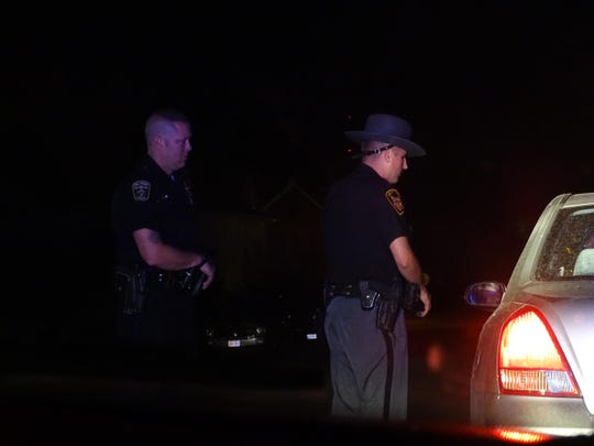 Deputy Matt Kidwell discusses the reason for pulling over a vehicle during a Friday night traffic stop. He said such stops in areas of increased patrols can lead to tips or even arrests.