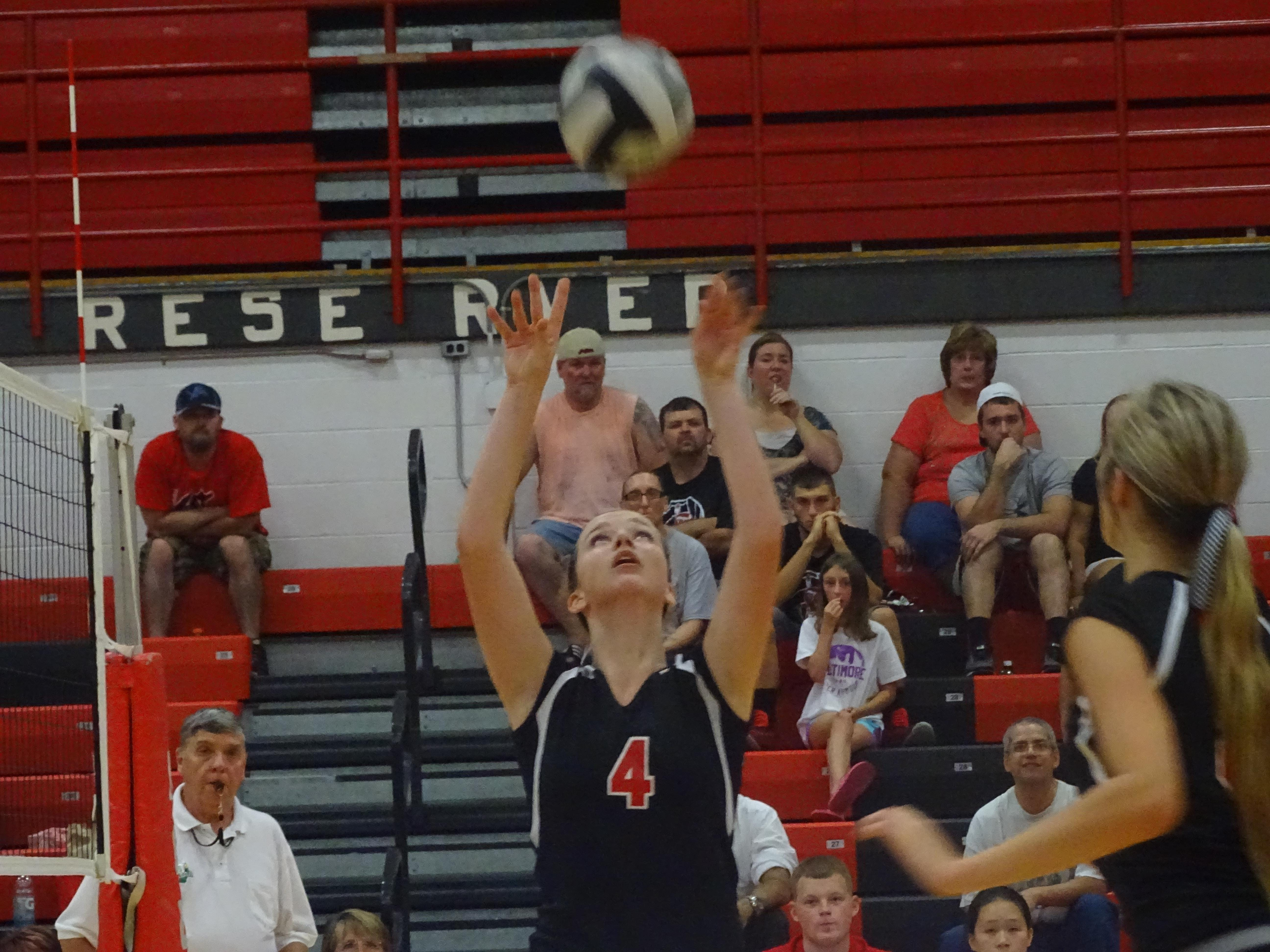 Lauren Hire sets the ball in Wednesday's game against Meadowbrook.