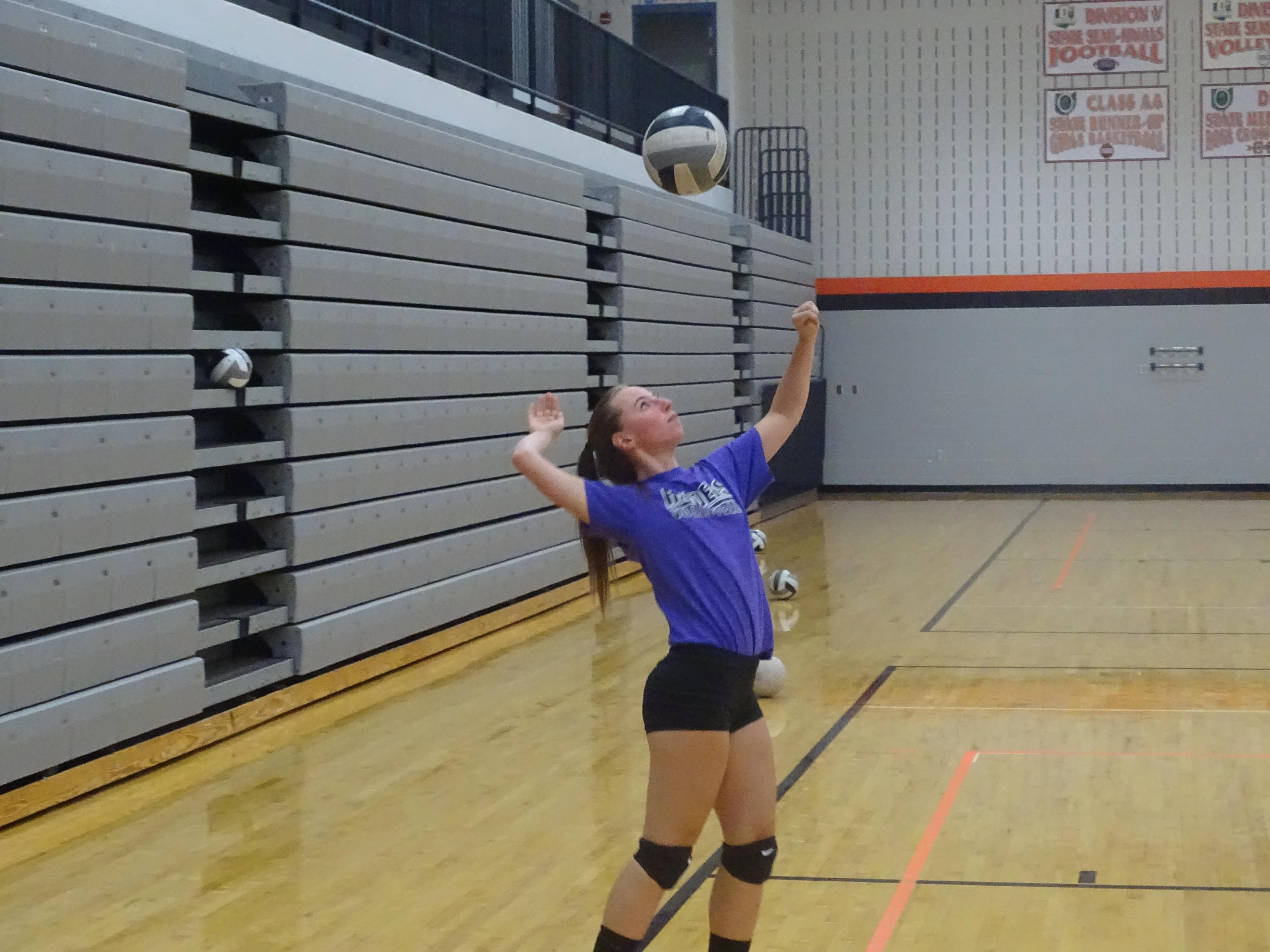 Junior Katie Leitz serves in practice Wednesday.