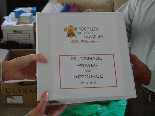 Greg and Carol Fox of Port Clinton show the binder of study material they were given prior to their trip this week to Philadelphia for Pope Francis' U.S. visit and the 2015 World Meeting of Families.