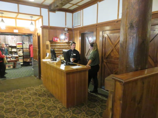 The check-in desk at the Many Glacier Hotel has been moved temporarily to the north side lounge during major construction this summer. The hotel's lobby will be restored next summer, including a double stair case similar and lighting similar to that when the hotel opened in 1915.