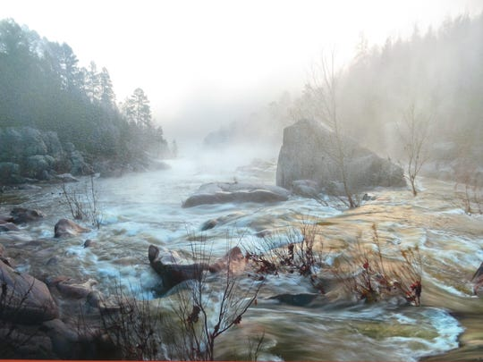 Dan Frisch, who has done commission work for many area corporations and businesses, captures early morning fog in this stunning image of an Ozarks creek.