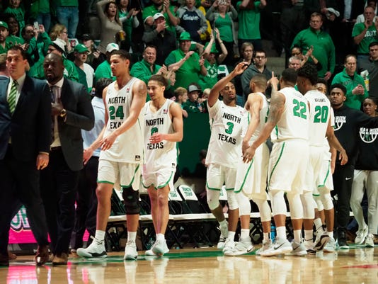 North Texas celebrates after defeating San Francisco in the second game of the College Basketball Invitational final series Wednesday, March 28, 2018, in Denton, Texas. (Jeff Woo/The Denton Record-Chronicle via AP)