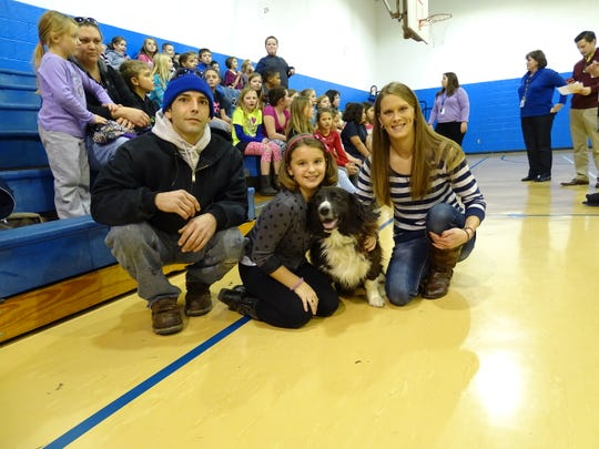 Kaylee Caplinger, middle, and her dog, Rex, won the Ross County auditor's #1 Dog in Ross County contest after she submitted an essay about Rex. Caplinger's parents, Jake Caplinger and Jessica Lutz, brought Rex to Mount Logan Elementary School for the auditor to give Kaylee and Rex their award.