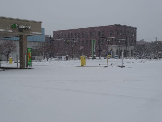 The scene Sunday morning from the Huntington Bank parking lot in Downtown Zanesville. The National Weather Service predicted one to four inches of snow for the region Sunday with snow turning to rain later in the day. Local law enforcement were reporting only a few minor traffic crashes late Sunday morning due to weather.
