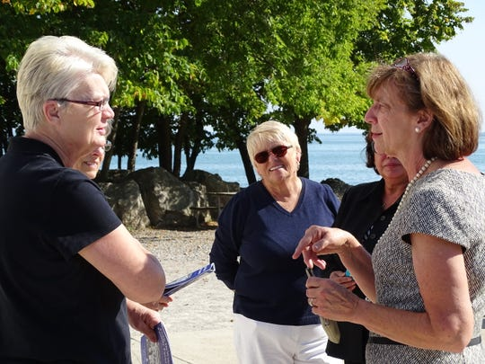 Fran DeWine, right, handed out copies of her cookbook while talking with people visiting the Marblehead Lighthouse.