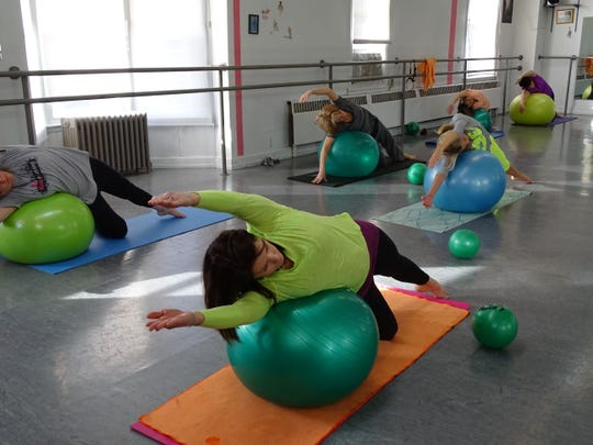 During Laura Tyson's Pilates class, students used resistance training to gain flexibility and strength. The workout intensifies when the class uses the medicine ball.