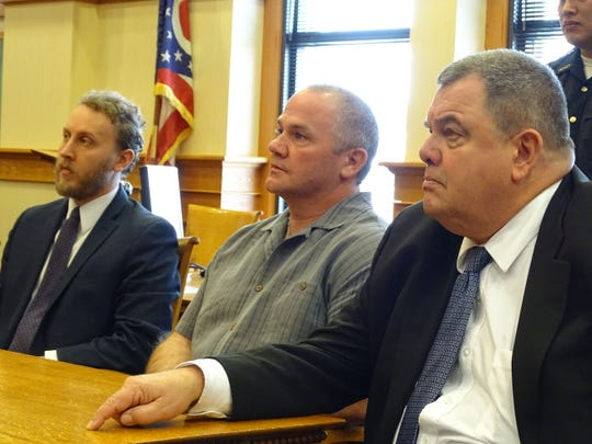 Darrell Domokos, center, with attorneys Tom DeBacco, right, and Chris Hill, left, entered a guilty plea on three felony counts, one for gross sexual imposition and two counts of unlawful sex with a minor.