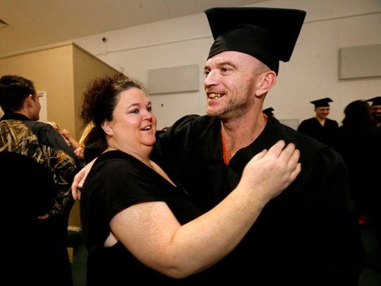 Rutherford County jail inmate Charles Estes gets a hug from his sister Lana Baker after passing the HiSET exam, earning him a high school equivalency diploma during a graduation ceremony on Nov. 30, 2017, at the Rutherford County Adult Detention Center.
