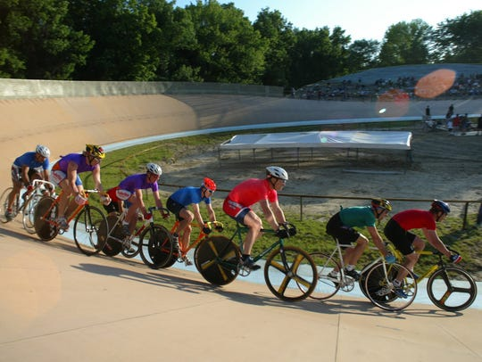 Riders race around on the Bloomer Park Velodrome in
