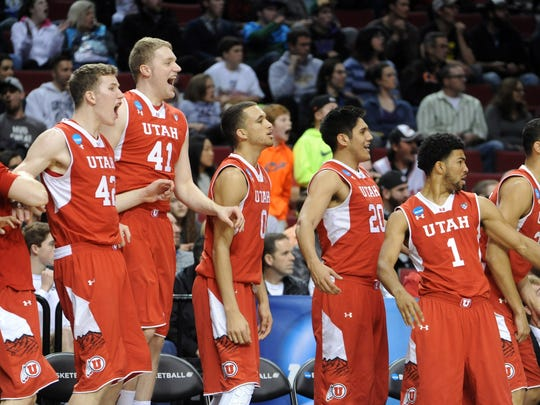 The Utah bench celebrates during the second half of an NCAA college basketball tournament round of 32 game against Georgetown  in Portland, Ore., Saturday, March 21, 2015.  Utah beat Georgetown 75-64.