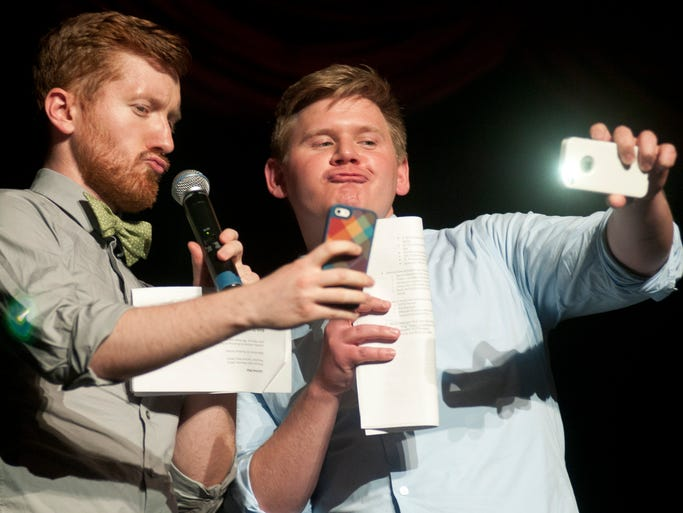 Emcees James Grogan and Chad Flowers take a selfies in between acts during the IU School of Medicine's annual Evening of the Arts at the Madame Walker Theatre, Saturday, April 12, 2014. Funds raised through the event support four free medical clinics around Indianapolis.