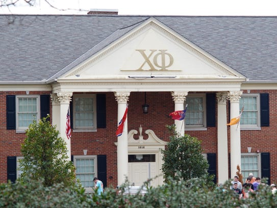 Members of the Chi Phi fraternity stand outside the